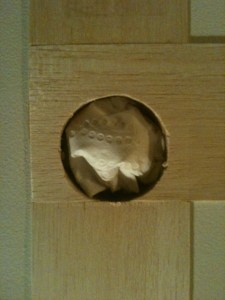 Doorknob aperture cut into balsa.