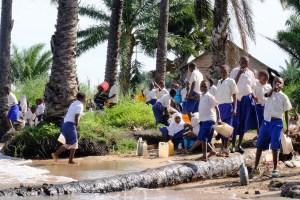 school children fetching water from lake Tanganyika
