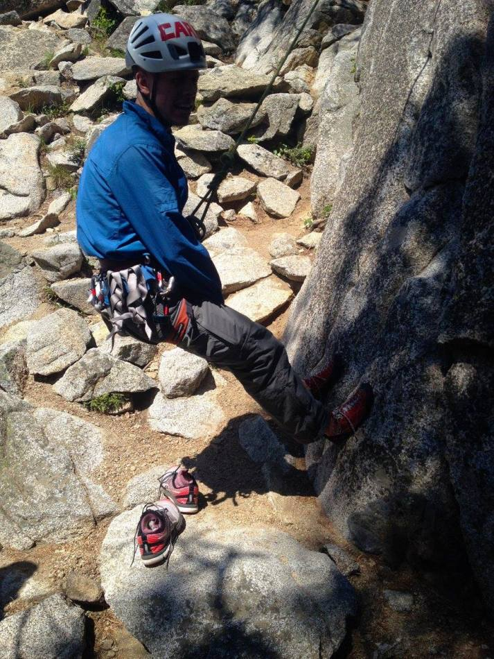 Weighting the rope so his belayer can practice escaping the belay
