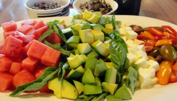 melon and avocado salad with a spicy seed brittle and a roasted tomato dressing