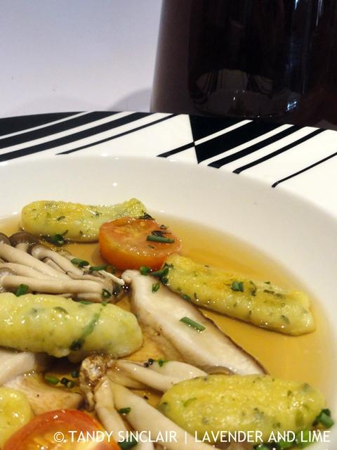 herb gnocchi and mushroom consommé