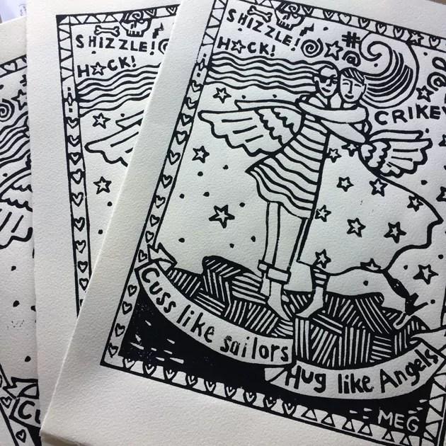 "3 black ink prints on white paper of ""cuss like sailors, hug like angels"""