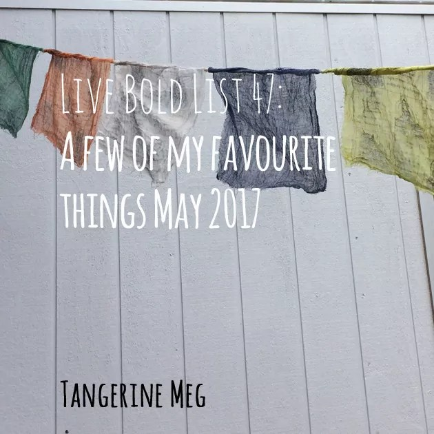 Header text in handwritten looking font, overlaid on a panelled pale grey wall with prayer flags hanging across the top third.