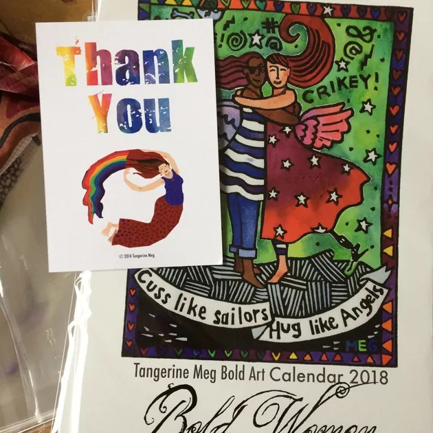 Thank You card on a pile of Bold Women art calendars amidst being wrapped in bubble wrap