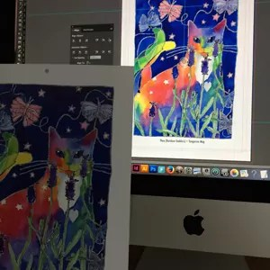 work in progress photo of a calendar art page and the matching picture on a computer screen