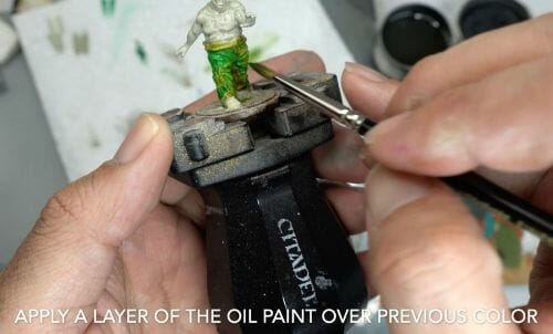 Painting a zombie RPG miniature with oil paints - painting RPG miniatures - oil painting miniatures - origin miniatures - how to paint rpg miniatures - how to paint dungeon and dragons miniatures - painting miniatures and models for role playing games - oil painting 28mm miniatures - thin layers of color