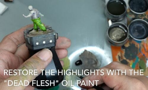Painting a zombie RPG miniature with oil paints - painting RPG miniatures - oil painting miniatures - origin miniatures - how to paint rpg miniatures - how to paint dungeon and dragons miniatures - painting miniatures and models for role playing games - oil painting 28mm miniatures - restore highlights