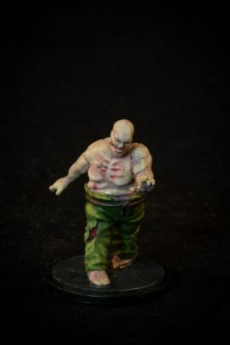 Painting a zombie RPG miniature with oil paints - painting RPG miniatures - oil painting miniatures - origin miniatures - how to paint rpg miniatures - how to paint dungeon and dragons miniatures - painting miniatures and models for role playing games - oil painting 28mm miniatures - front photo