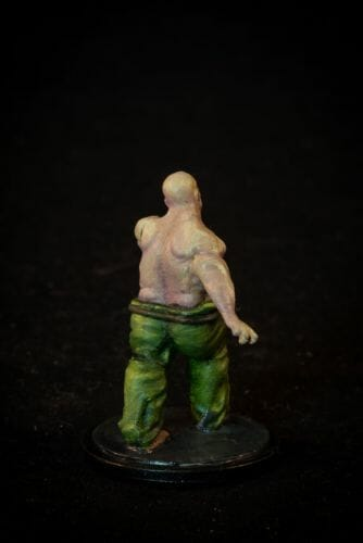 Painting a zombie RPG miniature with oil paints - painting RPG miniatures - oil painting miniatures - origin miniatures - how to paint rpg miniatures - how to paint dungeon and dragons miniatures - painting miniatures and models for role playing games - oil painting 28mm miniatures - rear view photo