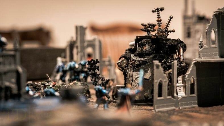 Is Warhammer 40K Worth It? Why You Need to Play Warhammer 40k - Is Warhammer 40k expensive? - Should I start playing warhammer 40000 - why you should play WH40k - ork gargant in a tabletop game of warhammer 40k