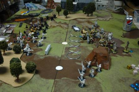 Face off. Turn 2. Menoth High Reclaimer versus Mercenaries Gorton.