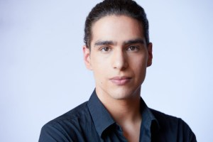 A portrait photograph of Yousef Kadoura. He wears a dark blue button up, his hair is pulled back. The background is light blue. Yousef Kadoura is an actor and writer, as well as a graduate of the National Theatre School of Canada. Yousef has worked with Tangled as an artist and in other capacities since moving to Toronto, his work is rooted in identity and social activism through storytelling. While in Residence at Tangled, Yousef will be working alongside the Artistic Director assisting in the development of Tangled's upcoming showcases.