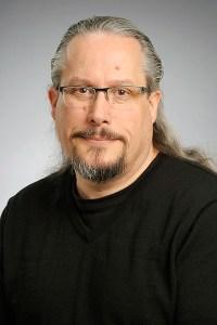 A headshot of David Garneau