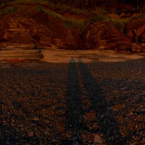 Cousins at Cap Bon Ami - two shadows in sand