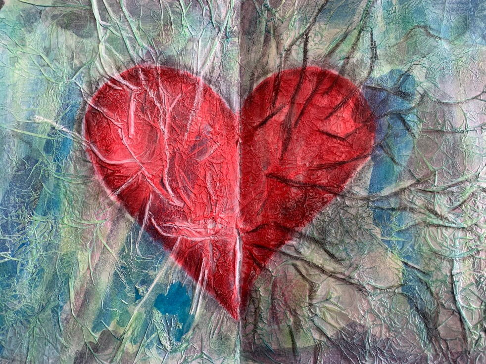 Mixed media painting of a cracked open heart