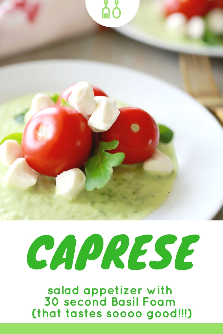Caprese salad appetizer with fresh Campari tomatoes, spring greens, and mozzarella pearls; all in a vibrantly flavored sweet basil foam.