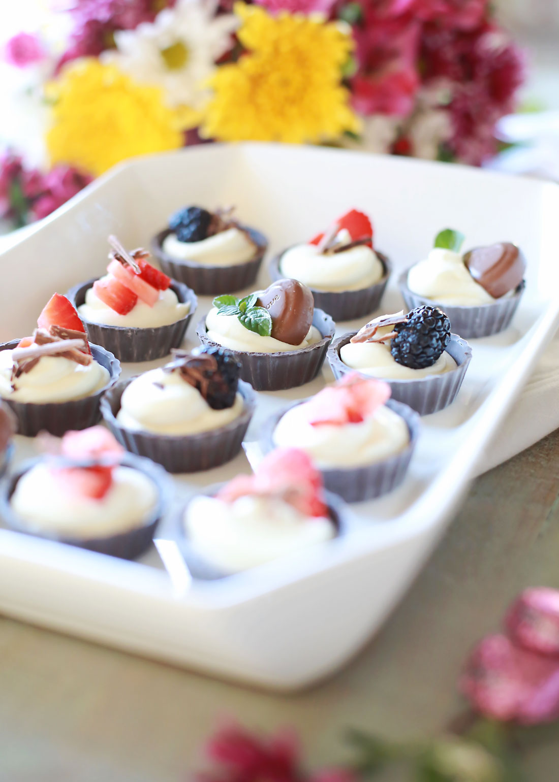 miniature chocolate cheesecakes with delicious toppings!