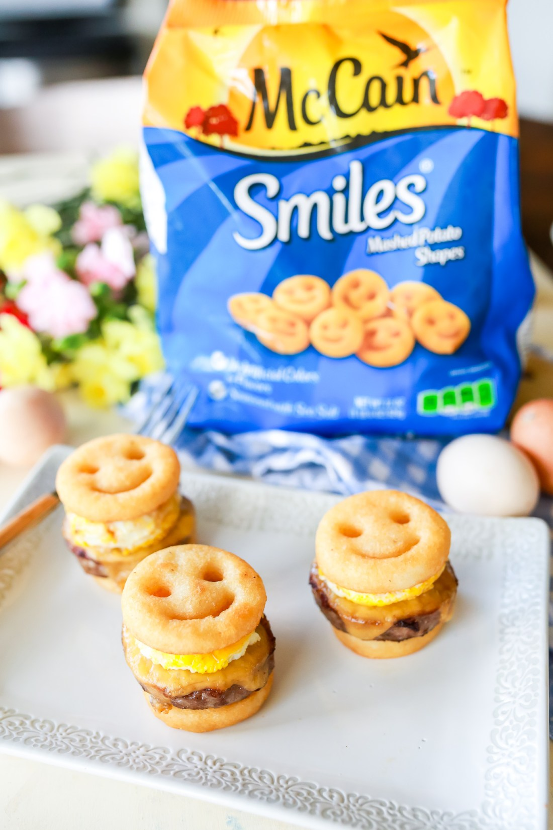 Quick, easy, & FUN family breakfast sliders! Sausage, egg, & cheese sandwiches reinvented into a simple but delicious sandwich the whole family can enjoy!