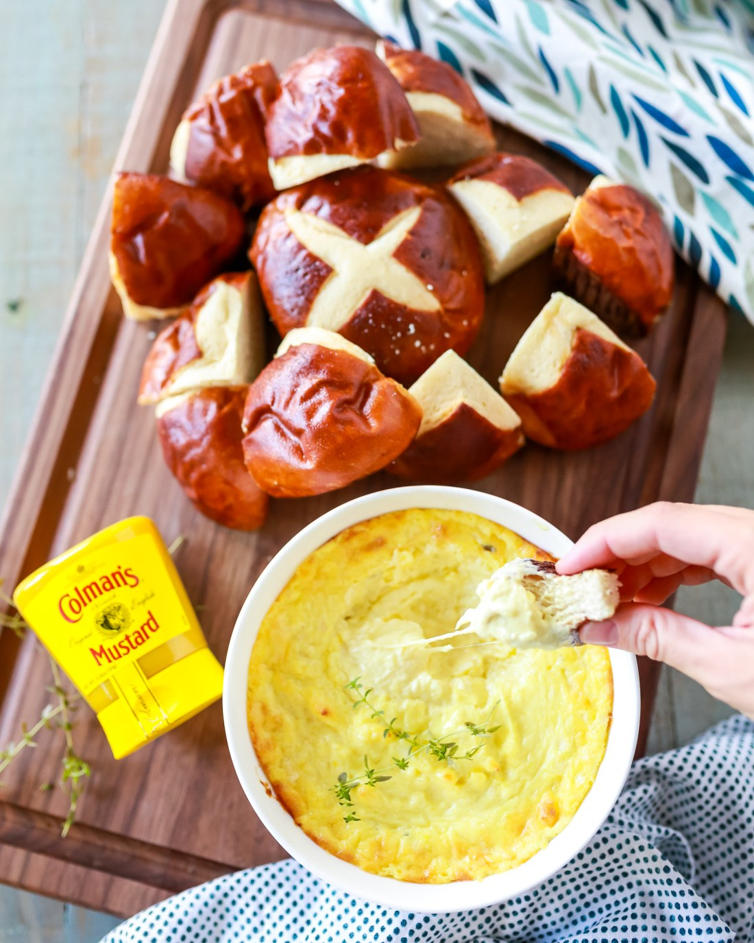 When mustard dipping sauce meets cheese fondue they make the most wonderful Mustard Cheese Dip that was seriously meant to go perfect with pretzels!