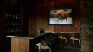 Aman Resort, Amangani, Jackson Hole, Wyoming, USA, travel destination, luxury, resort, interior bar buffalo photograph, bar, lounge, hotel