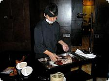 Chef prepares to serve Peking Duck at 19