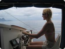 At the helm of a catamaran off BoraBora