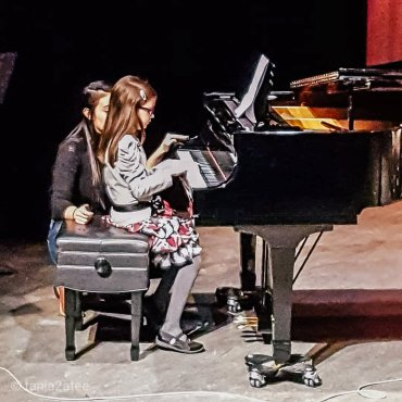 The Little Mouse playing piano at a Holiday Concert