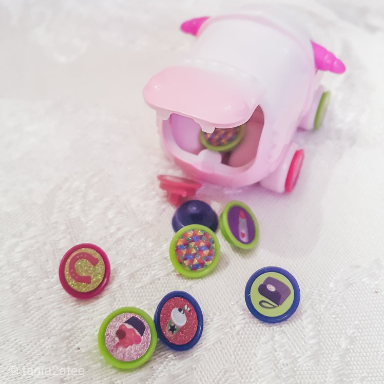Assortment of Ritzy Rollerz miniature car collectible toy with charms and trunk