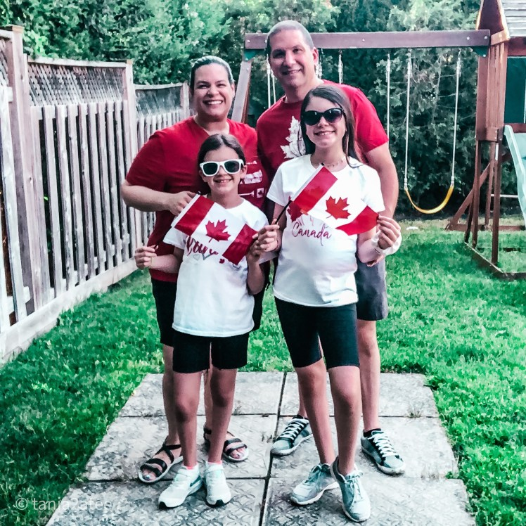 tania2atee-blog-family-of-four-holding-Canadian-flags