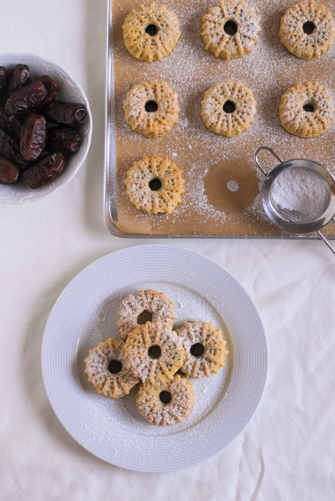 Ma'amoul Bil Tamer (Semolina Date Cookies) with powdered sugar