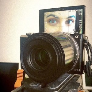 dslr camera with women's eyes showing on the screen