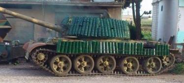 T-62 with unusual armor (old shell casings?)