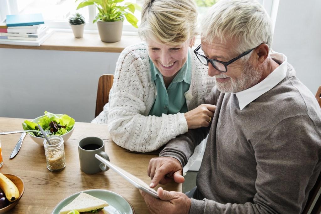 senior man and woman using tablet
