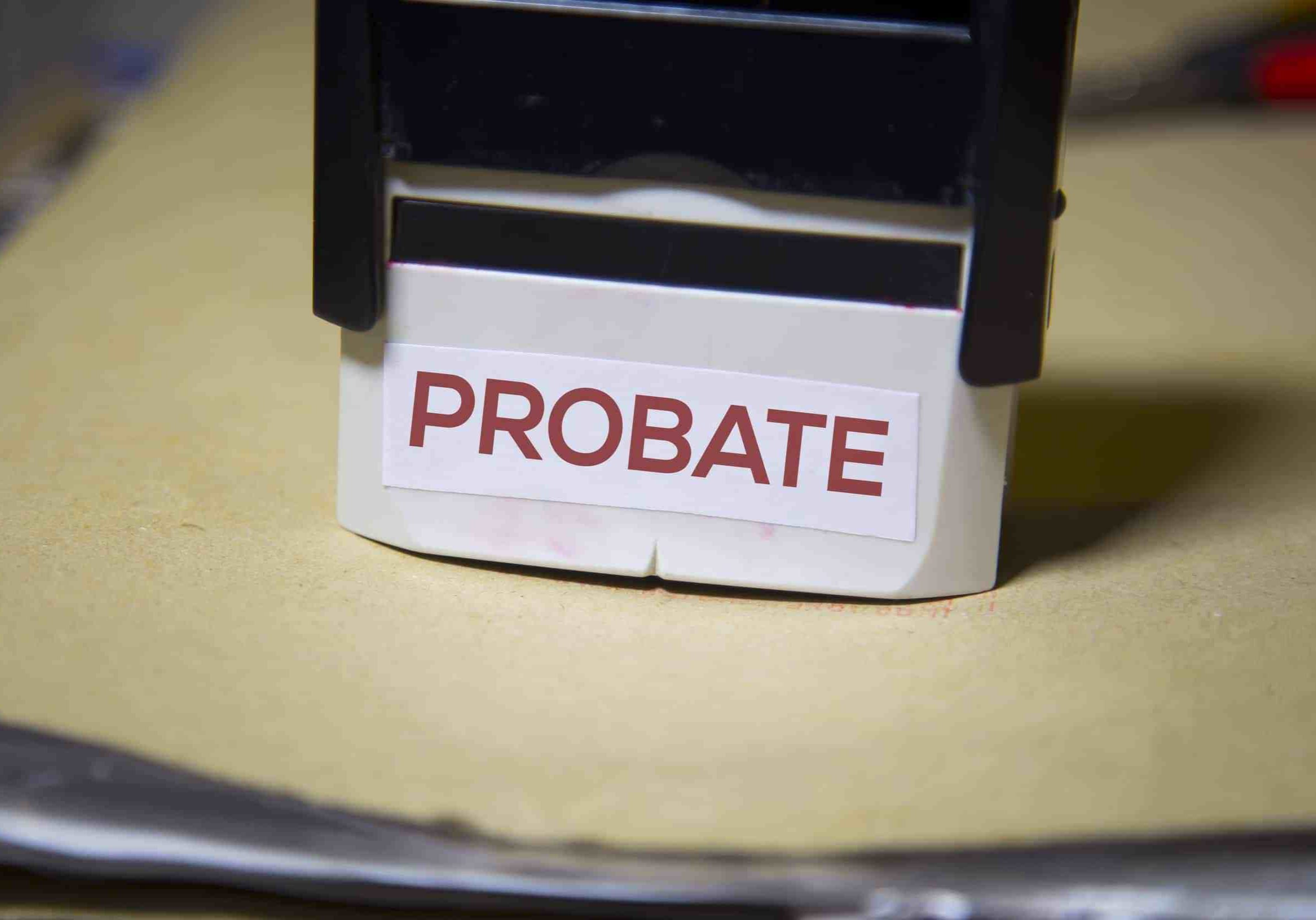 The word probate on a stamp on a big folder of paperwork