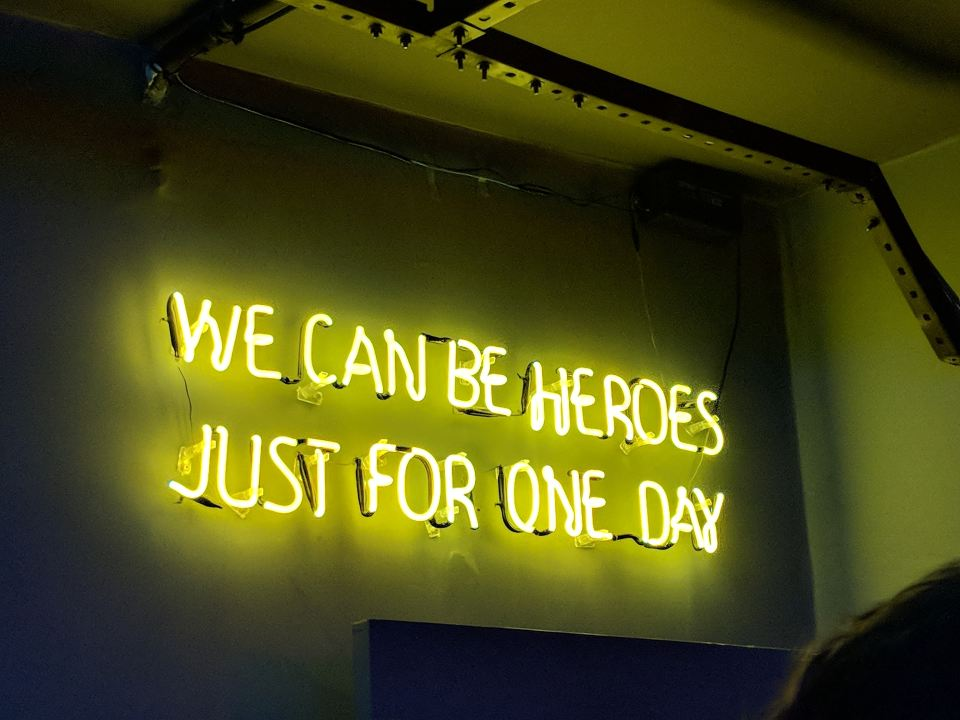 a neon sign that says we can be heroes just for one day