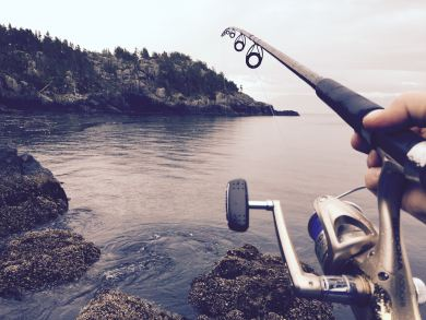 a first-person picture of a fishing rod cast out into the water