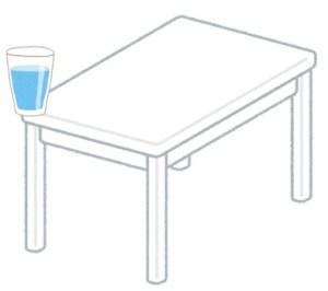 テーブルからコップが落ちそうなイラスト