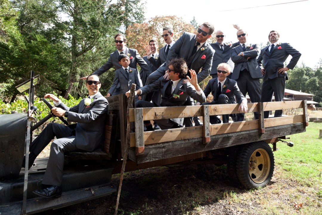 Groom and his best men wearing dark glasses in truck