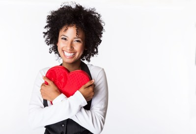 Pretty woman holding heart box in her arms