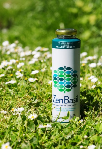Product shot of healthy green drink on grass
