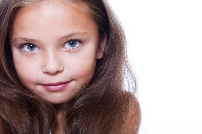 Close-up of 7-year-old girl with long hair