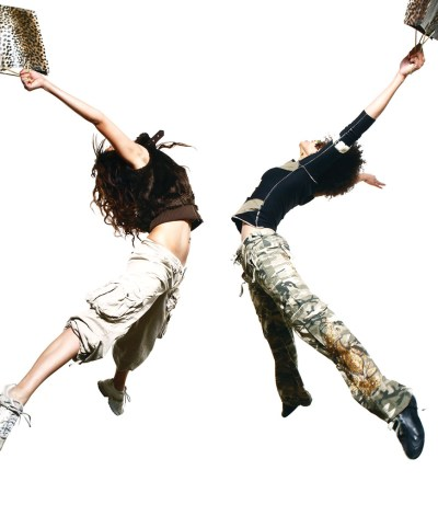 Two female jazz dancers jumping in the air