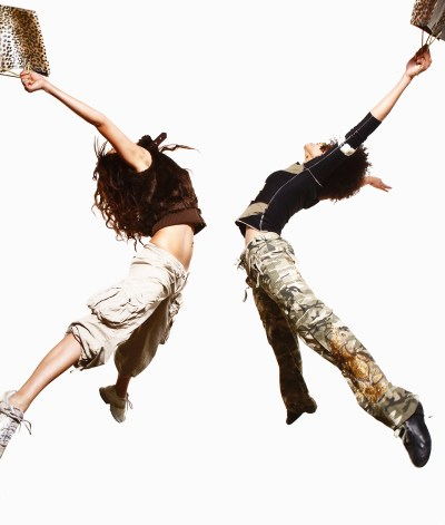 Two female dancers jumping in the air