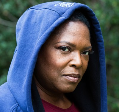 Headshot of serious woman wearing a hoodie