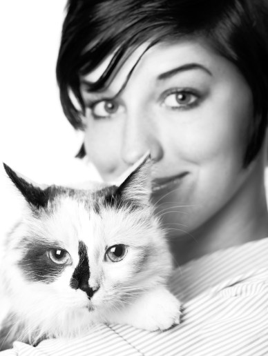 Black & white shot of cat and pretty woman
