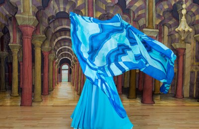 Woman dancer with blue scarf flowing