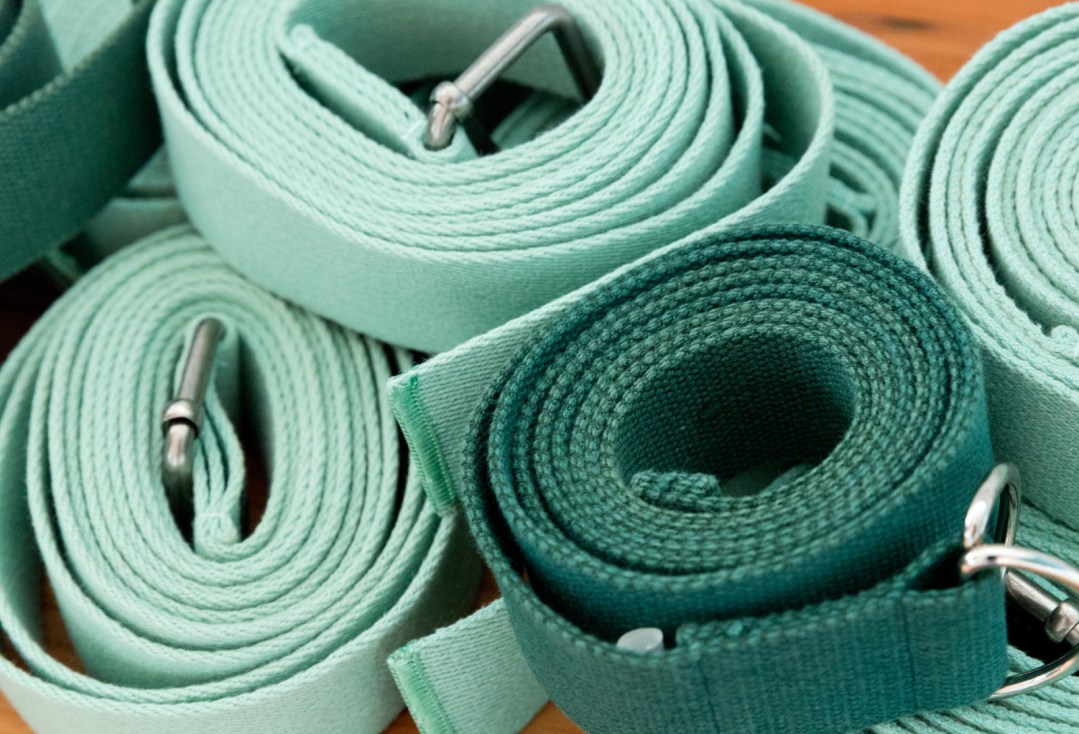 Product shot of green yoga belts