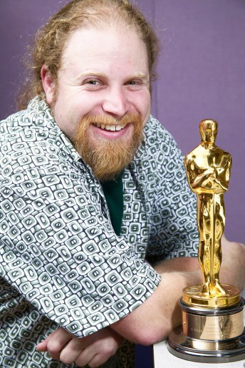 Portrait of happy man with his Oscar