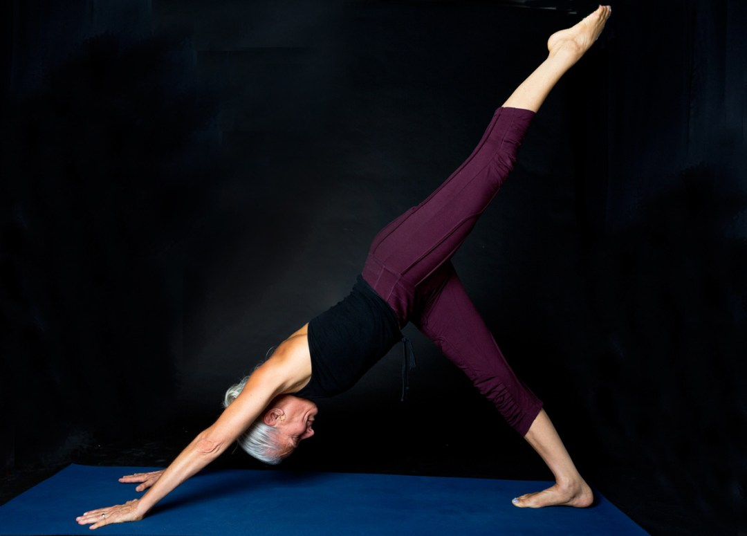 Woman yogi doing a yoga pose