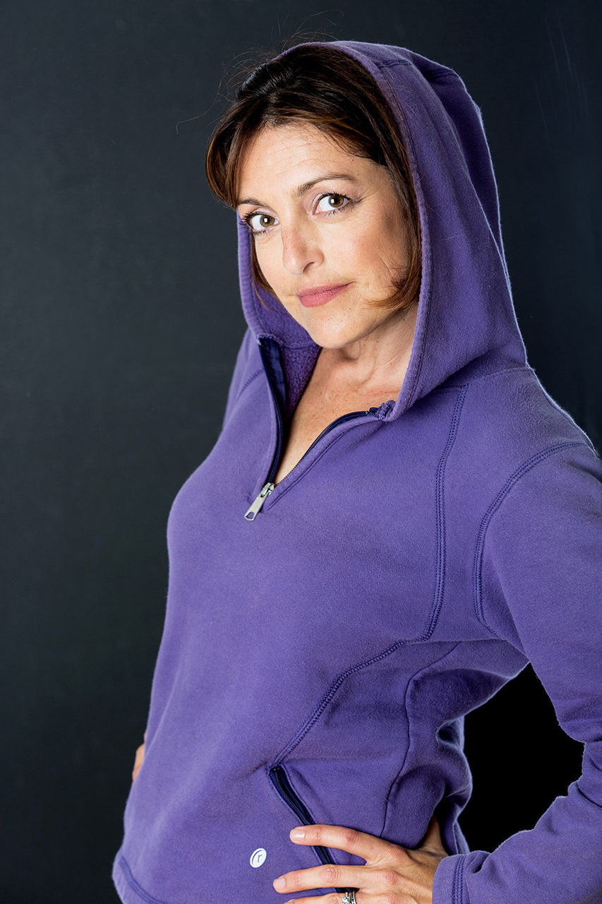 3/4 shot of woman wearing a hoodie